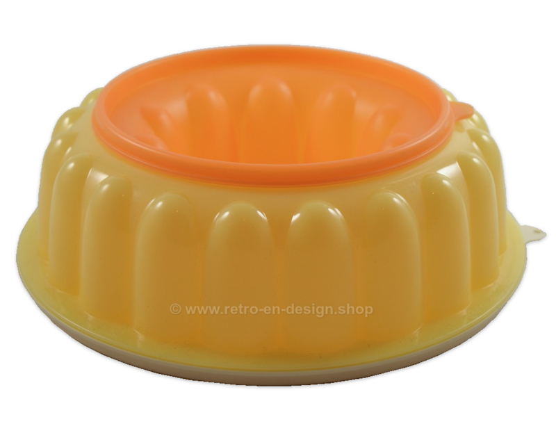 Vintage Tupperware pudding mould in orange-yellow