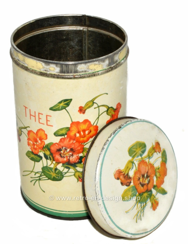 Vintage tin cylindrical tea canister with floral decoration