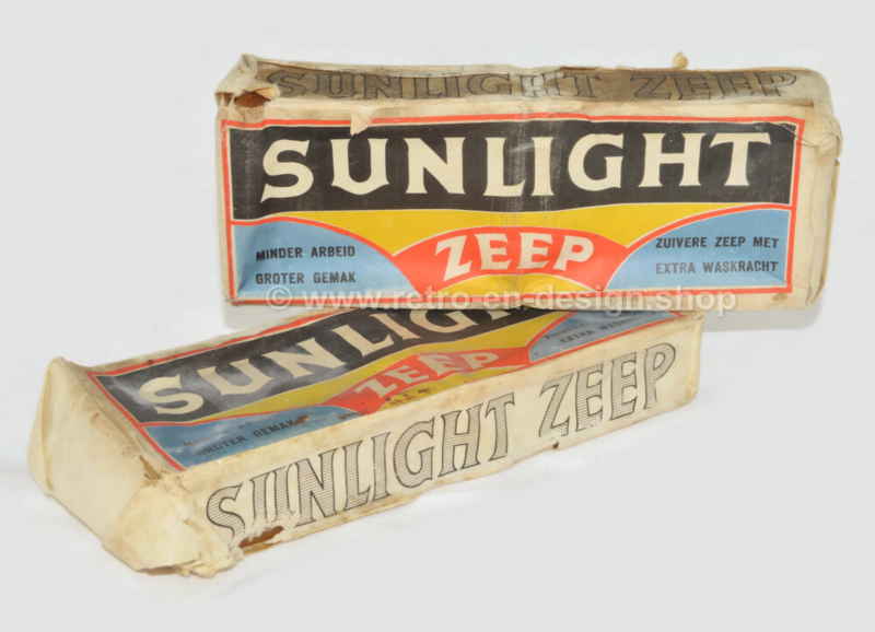 Two double pieces of Sunlight soap folded into packaging