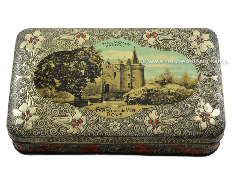 Old vintage tin drum with an image of the HELMOND Castle