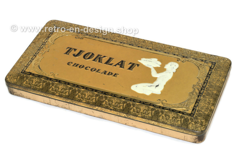 Rectangular tin box with an oriental woman with a bowl of cocoa beans for chocolate by Tjoklat-Fabriek N.V. Amsterdam.