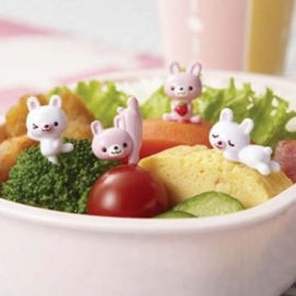 Roze en witte konijntjes prikkers
