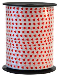 5. krullint - wit met rode hartjes