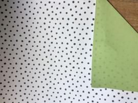 Inpakpapier dots met een effen groene achterzijde