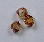3 mm Crystal Metallic Sunshine Swarovski Element Bicones