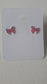 unicorn met roze en paarze manen