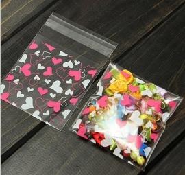 1 mini zakje hartjes roze 7x7cm