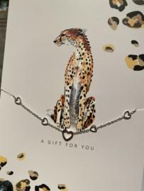 """Stainless steel armbandje met hartjes op kaart """"A gift for you"""". Zilver"""