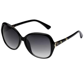 Mooie grote zonnebril, leuke bewerkte zijkant. Zwart montuur