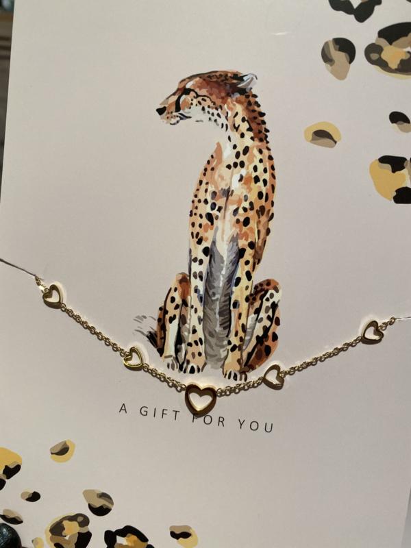 "Stainless steel armbandje met hartjes op kaart ""A gift for you"". Goud."