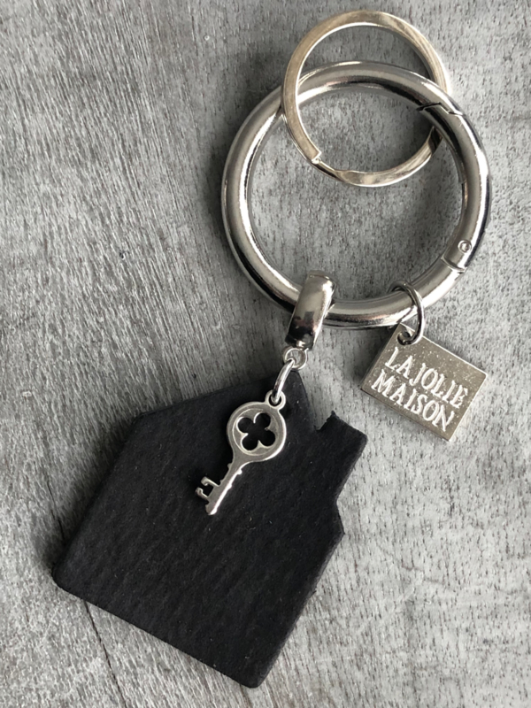 Tas- sleutelhanger van La Jolie Maison. HOME. Zwart leer