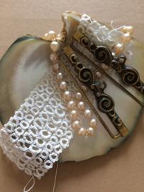 VERKOCHT | Schellekoord ornament | Set in koperbeslag | Roosjes