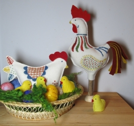 Haan, kip, kuikens en eieren.