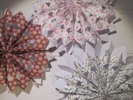 Papieren zakken voor de kerstster