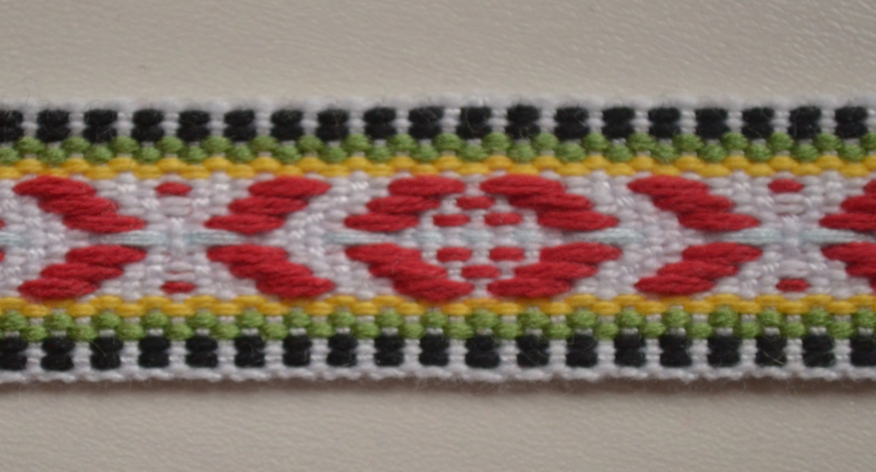 Wit-rood multicolour.   Prijs per meter