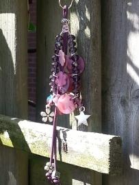 paarse facet kraal met sterretje en bloem