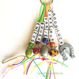 Gelukspoppetjes sleutelhanger met 5 gelukspoppetjes