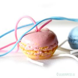 Roze en blauwe geluksmacarons