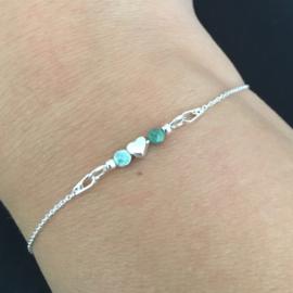 Zilveren armband met hartje en edelsteentjes