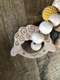 Rammelaar met houten bijt figuur