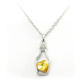 Goudgeel hart in flesje met ketting