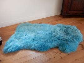 Lederen schapenvacht turquoise