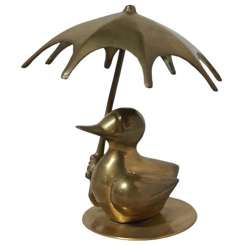 Messing eend met paraplu