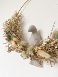 Dried floral wreath bird sand