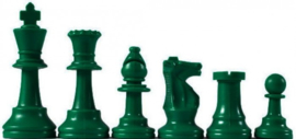 Green plastic chess pieces