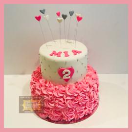 Roze rozetten opgespoten taart 16 personen