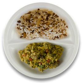 Rundercurry met spinazie, rijst met linzen en ui
