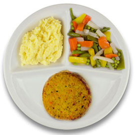 Veg. Griekse schnitzel met vegetarische jus, aardappelpuree, gemengde groenten