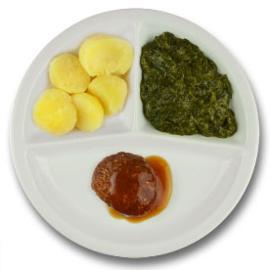 Rundergehaktbal met vleesjus, gekookte aardappelen, spinazie à la crème