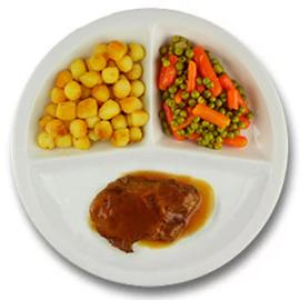 Varkensprocureurlapje met vleesjus, geb. aardappelen, wortelen met doperwten GLUTENVRIJ