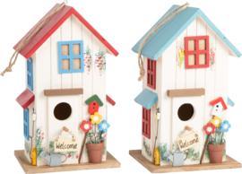 Twee kleurige vogelhuisjes