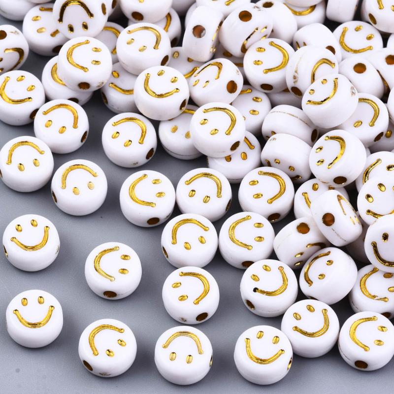 Smilie goud wit acrylic kraal gemixt