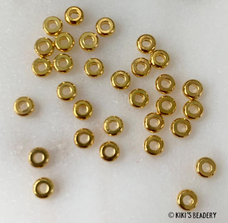 Ronde platte gouden spacerbeads  3,5mm