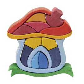 Houten paddenstoel huis gekleurd