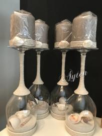 Wijnglas schelpen.  met tope kaars