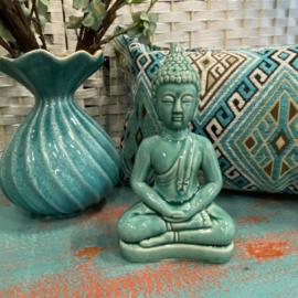 Keramieken Boeddha in de kleur turquoise groen