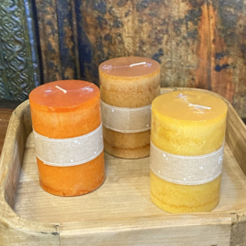 Set van drie kaarsen in de kleuren oker, camel en oranje 10cm hoog x 7cm dik