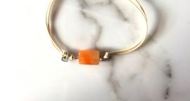 Bazou Armbandje met oranje steentje