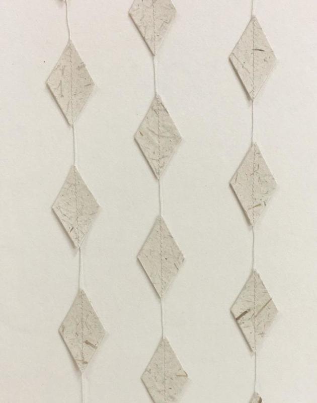 Woonslinger   ruit olifantenpoep papier