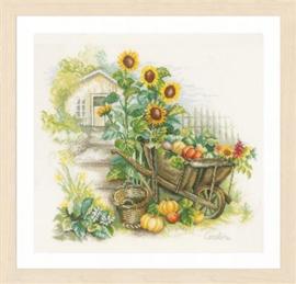 Kruidwagen en zonnebloemen