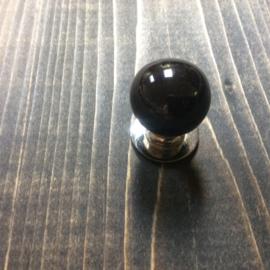 Klein zwart bol knopje