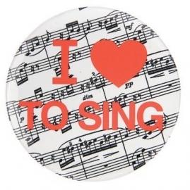 Button met tekst 'I ♥ To Sing'