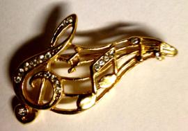 Broche met gouden notenbalk