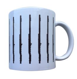 Koffiekopje met dwarsfluiten