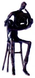 Bronzen beeldje hoornist