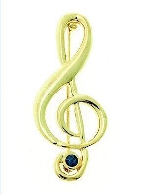 Broche met gouden vioolsleutel